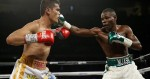 Guillermo Rigondeaux, right, punches Drian Francisco during their super bantamweight bout Saturday, Nov. 21, 2015, in Las Vegas. (AP Photo/John Locher)
