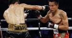 Takashi Miura, left, of Japan, hits Francisco Vargas, of Mexico, during a WBC junior lightweight title bout Saturday, Nov. 21, 2015, in Las Vegas. (AP Photo/John Locher)