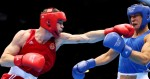 LONDON, ENGLAND - AUGUST 12:  Egor Mekhontcev (L) of Russia throws a punch against Adilbek Niyazymbetov (R) of Kazakhstan during the Men's Light Heavy (81kg) Boxing final bout on Day 16 of the London 2012 Olympic Games at ExCeL on August 12, 2012 in London, England.  (Photo by Scott Heavey/Getty Images)