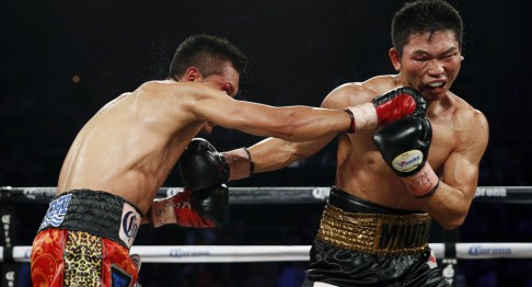 Takashi Miura, right, of Japan, and Francisco Vargas, of Mexico, trade punches during a WBC junior lightweight title bout Saturday, Nov. 21, 2015, in Las Vegas. (AP Photo/John Locher) ORG XMIT: NVJL116